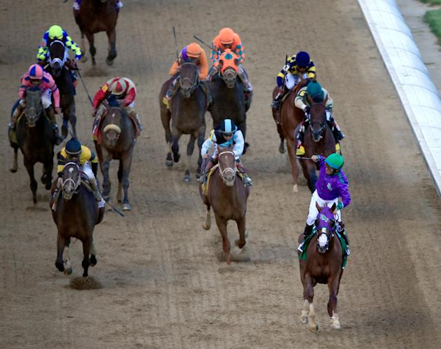 LOUISVILLE, KY - MAY 03: Calofirnia Chrome crosses the finish line to win the 140th running of the Kentucky Derby at Churchill Downs on May 3, 2014 in Louisville, Kentucky. (Photo by Jamie Squire/Getty Images)