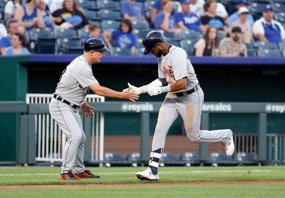 Willi Castro of the Detroit Tigers is congratulated by third base coach Chip Hale after hitting a two-run home run during the fourth inning of the game against the Kansas City Royals at Kauffman Stadium in Kansas City, Missouri, on Monday, June 14, 2021.