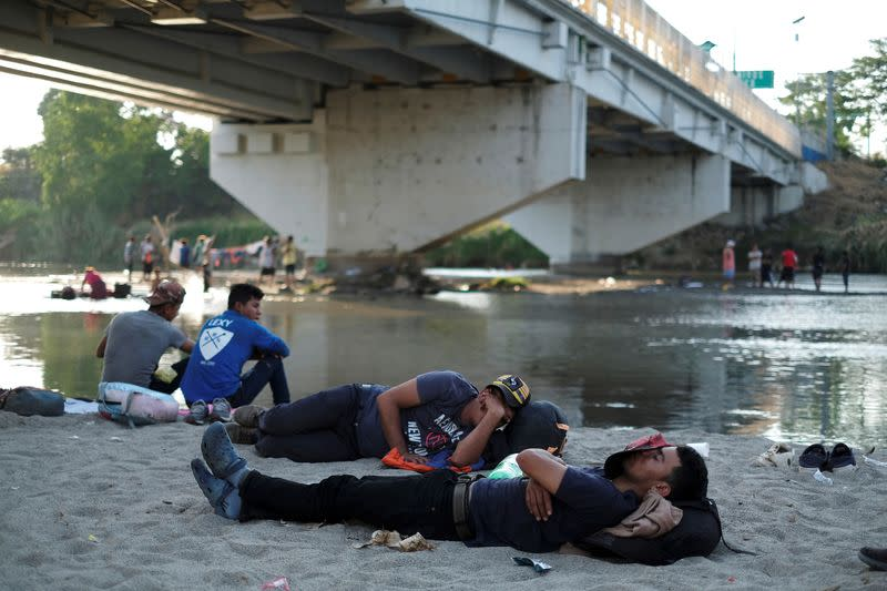 Migrant travelling to the U.S. rest by the Suchiate river at the border between Guatemala and Mexico, in Tecun Uman