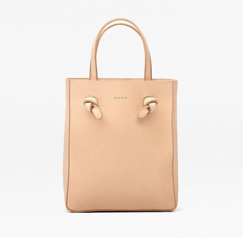 "Nisolo is known for its ethically crafted vegan leather goods, and this crossbody shopper is a best-seller, with reviewers praising the bag's quality and detailed craftsmanship. $160, Nisolo. <a href=""https://nisolo.com/products/womens-leather-crossbody-bucket-bag-natural-vachetta"" rel=""nofollow noopener"" target=""_blank"" data-ylk=""slk:Get it now!"" class=""link rapid-noclick-resp"">Get it now!</a>"