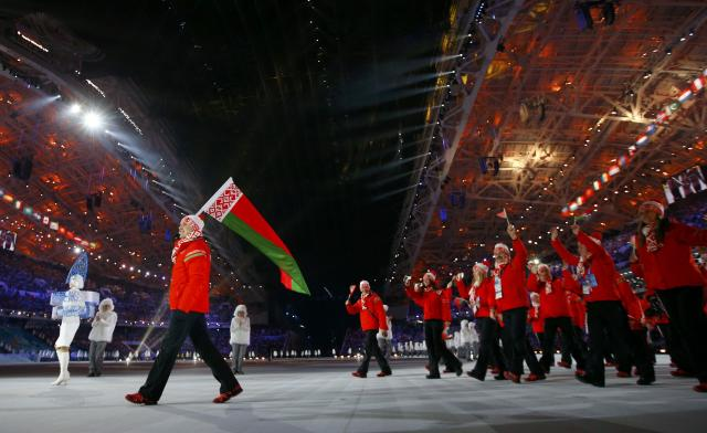 Belarus' flag-bearer Alexei Grishin leads his country's contingent during the opening ceremony of the 2014 Sochi Winter Olympic Games February 7, 2014. REUTERS/Brian Snyder (RUSSIA - Tags: SPORT OLYMPICS)