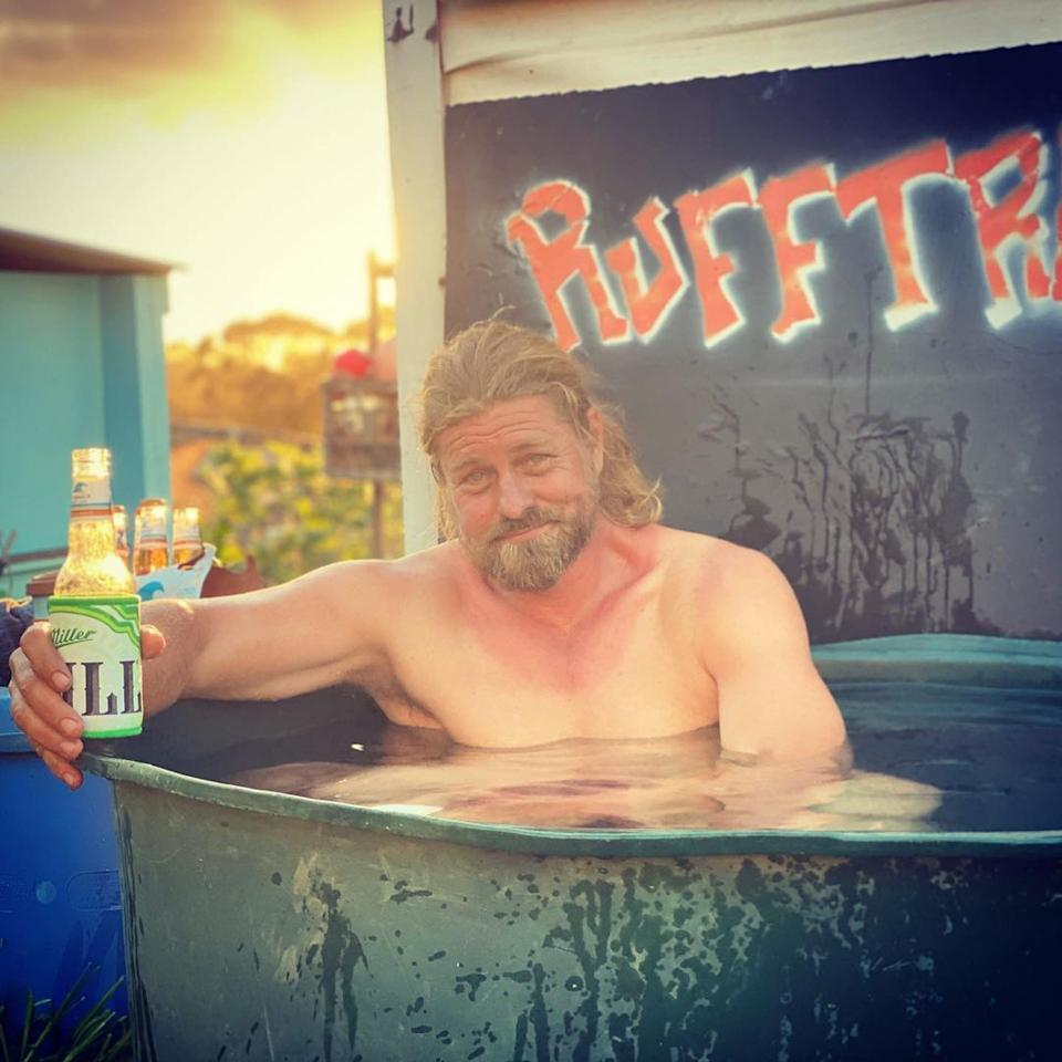Big Brother's David 'Farmer Dave' Graham shirtless drinking a beer in a water trough