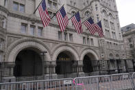 FILE - In this Jan. 15, 2021 file photo, extra security barricades are outside the Trump Hotel in Washington. Trump is returning to a family business ravaged by pandemic shutdowns, with revenue plunging more than 40 percent at his Doral golf property, his Washington hotel and at both his Scottish resorts. Trump's financial disclosure released as he left office this week was just the latest bad news for his financial empire after banks, brokerages and golf organizations announced they were cutting ties with his company following the storming of the Capitol this month by his political supporters (AP Photo/Susan Walsh, File)