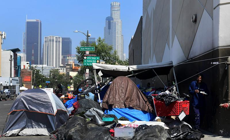 Belongings of the homeless crowd a downtown Los Angeles sidewalk in Skid Row.