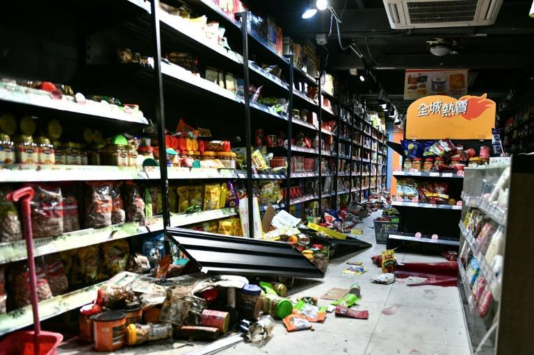 Hardcore pro-democracy protesters in Hong Kong vandalised this store in the northern district of Yuen Long (AFP Photo/Anthony WALLACE)