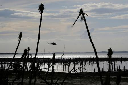 FILE PHOTO: An unidentified helicopter lands to deliver food and water in the aftermath of Hurricane Dorian in Marsh Harbour
