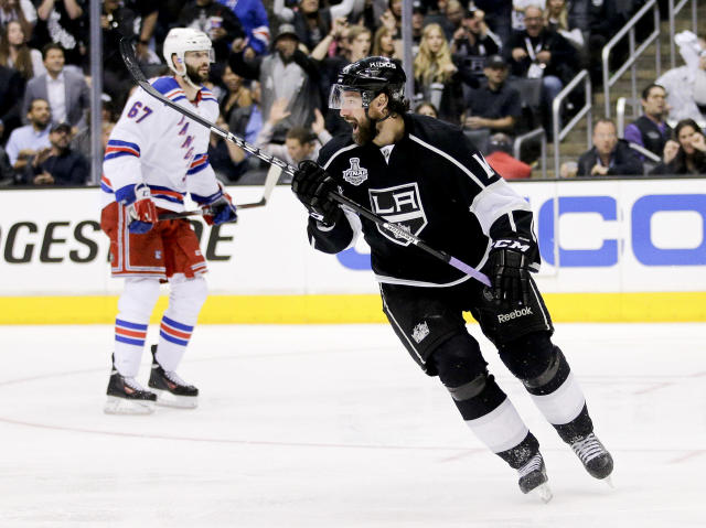 Los Angeles Kings right wing Justin Williams, right, celebrates his game winning goal as New York Rangers left wing Benoit Pouliot looks on in overtime of Game 1 in the NHL Stanley Cup Final hockey series on Wednesday, June 4, 2014, in Los Angeles.(AP Photo/Jae C. Hong)