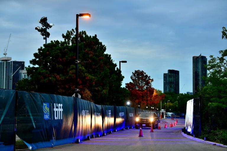 """Signs on display at the opening night premiere of """"David Byrne's American Utopia"""" during the 2020 Toronto International Film Festival at RBC Lakeside Drive-In at Ontario Place on September 10, 2020 in Toronto, Ontario"""