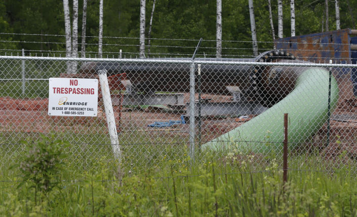 FILE - In this June 29, 2018 file photo, a No Trespassing sign is visible at a Enbridge Energy pipeline drilling pad along a rail line that traces the Minnesota-Wisconsin border south of Jay Cooke State Park in Minnesota. After President Joe Biden revoked Keystone XL's presidential permit and shut down construction of the long-disputed pipeline that was to carry oil from Canada to Texas, opponents of other pipelines hoped the projects they've been fighting would be next. (AP Photo/Jim Mone File)