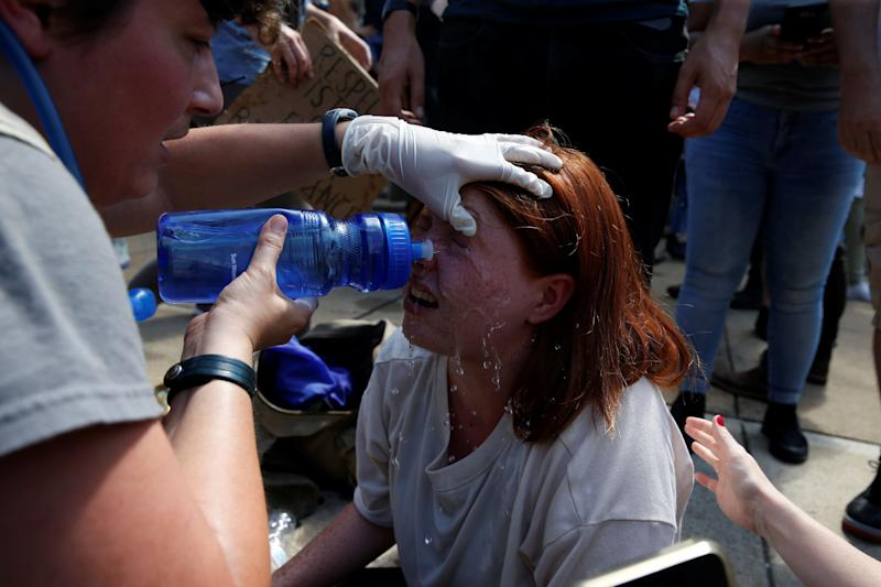 A protester receives first-aid during a clash between white nationalists and counter-protesters.