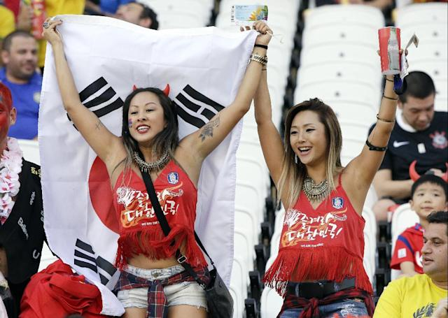 South Korea fans hold a flag as they cheer prior to the group H World Cup soccer match between South Korea and Belgium at the Itaquerao Stadium in Sao Paulo, Brazil, Thursday, June 26, 2014. (AP Photo/Lee Jin-man)