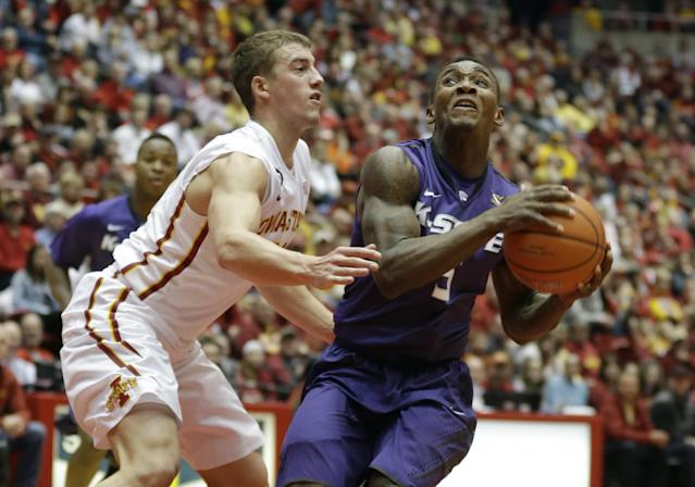 Kansas State guard Jevon Thomas, right, drives to the basket past Iowa State guard Matt Thomas during the first half of an NCAA college basketball game, Saturday, Jan. 25, 2014, in Ames, Iowa. (AP Photo/Charlie Neibergall)