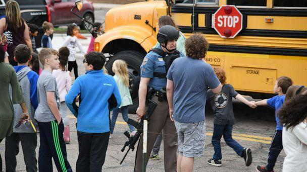 PHOTO: Students are escorted to a school bus in front of STEM School Highlands Ranch after a shooting, May 7, 2019, in Highlands Ranch, Colo. (Hyoung Chang/The Denver Post via Getty Images)
