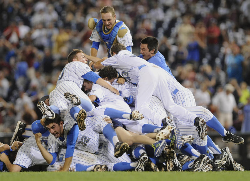 UCLA players including catcher Shane Zeile, top, pile onto one another after beating Mississippi State 8-0 in Game 2 of the NCAA College World Series baseball finals, Tuesday, June 25, 2013, in Omaha, Neb., winning the championship. (AP Photo/Eric Francis)