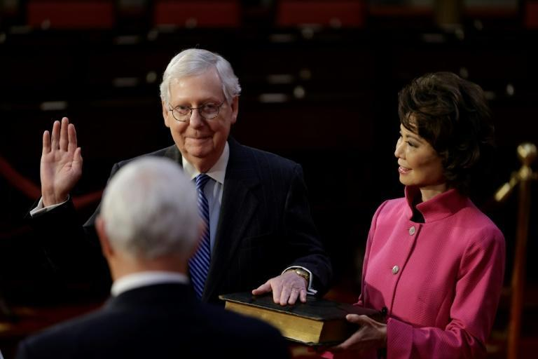 US Senate Majority Leader Mitch McConnell, seen with his wife Elaine Chao, the former secretary of transportation, at a mock swearing in on January 3, 2021 for his seventh term as a US senator