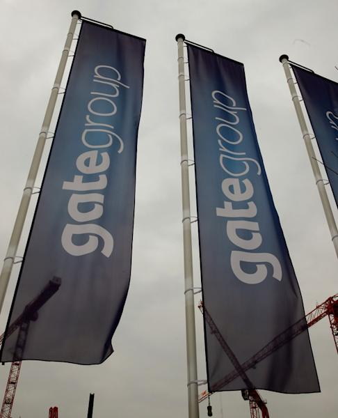 Flags of airline caterer Gategroup fly at the facility of their Gate Gourmet division at Zurich Airport in Kloten