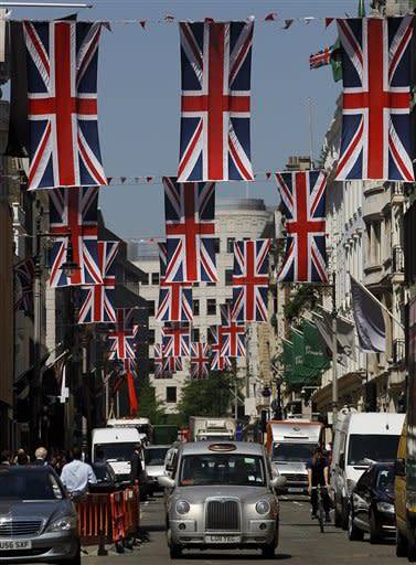 British Union flags fly above New Bond Street in London, Friday, May 25, 2012. The capital is preparing to celebrate the Diamond Jubilee, marking the Queen's 60 year reign. (AP Photo/Kirsty Wigglesworth)