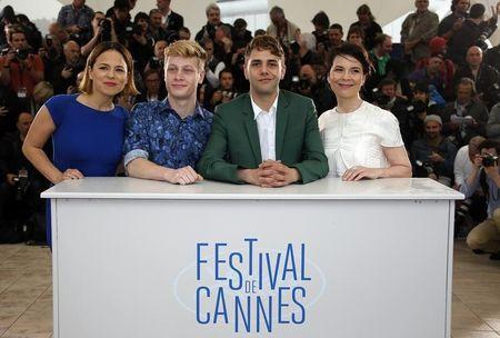"Director Xavier Dolan, cast members Suzanne Clement, Antoine-Olivier Pilon and Anne Dorval pose during a photocall for the film ""Mommy"" in competition at the 67th Cannes Film Festival in Cannes"