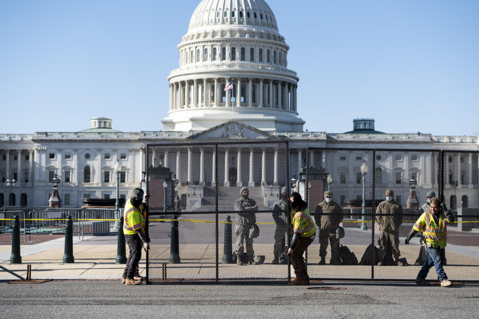 UNITED STATES - JANUARY 7: Workers install more robust fencing along the east side of the U.S. Capitol on Thursday morning, January 7, 2021, following the riot at the Capitol the day before. (Photo By Bill Clark/CQ-Roll Call, Inc via Getty Images)