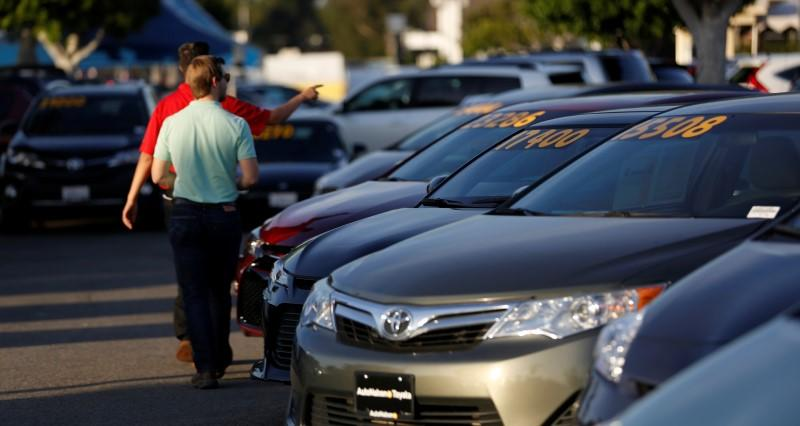 File photo of people look at vehicles for sale on the lot at AutoNation Toyota dealership in Cerritos