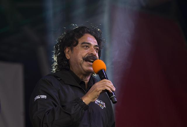 Shahid Khan, the owner of the Jacksonville Jaguars, speaks on stage during an NFL fan rally in Trafalgar Square, London, Saturday, Oct. 26, 2013. The San Francisco 49ers are due to play the the Jacksonville Jaguars at Wembley stadium in London on Sunday, Oct. 27 in a regular season NFL game. (AP Photo/Matt Dunham)