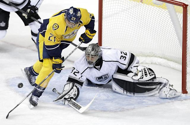 Los Angeles Kings goalie Jonathan Quick (32) blocks a shot as Nashville Predators forward Patric Hornqvist (27), of Sweden, reaches for the rebound in the first period of an NHL hockey game Thursday, Oct. 17, 2013, in Nashville, Tenn. (AP Photo/Mark Humphrey)