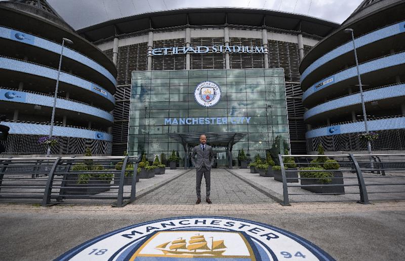 Manchester City, whose coach Pep Guardiola is seen standing in front of the team's stadium in July 2016, is reviewing Barry Bennell's involvement with the club as child sexual abuse allegations come to light (AFP Photo/Oli Scarff)