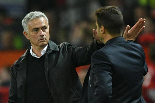 Old friends: Jose Mourinho and Mauricio Pochettino (AFP Photo/Oli SCARFF)