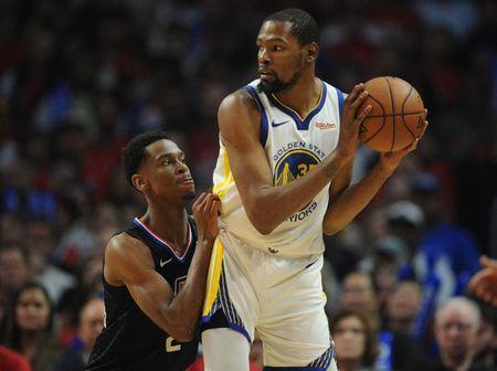 April 21, 2019; Los Angeles, CA, USA; Golden State Warriors forward Kevin Durant (35) controls the ball against Los Angeles Clippers guard Shai Gilgeous-Alexander (2) during the second half in game four of the first round of the 2019 NBA Playoffs at Staples Center. Mandatory Credit: Gary A. Vasquez-USA TODAY Sports