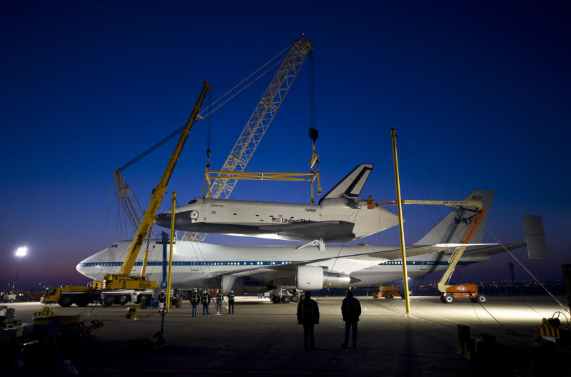 In this photo provided by NASA, the space shuttle Enterprise rests atop of the NASA 747 Shuttle Carrier Aircraft for transport to New York at Washington Dulles International Airport, Friday, April 20, 2012, in Sterling, Va. Enterprise is expected to go on display at the Intrepid Sea Air and Space Museum in New York. (AP Photo/NASA, Bill Ingalls)