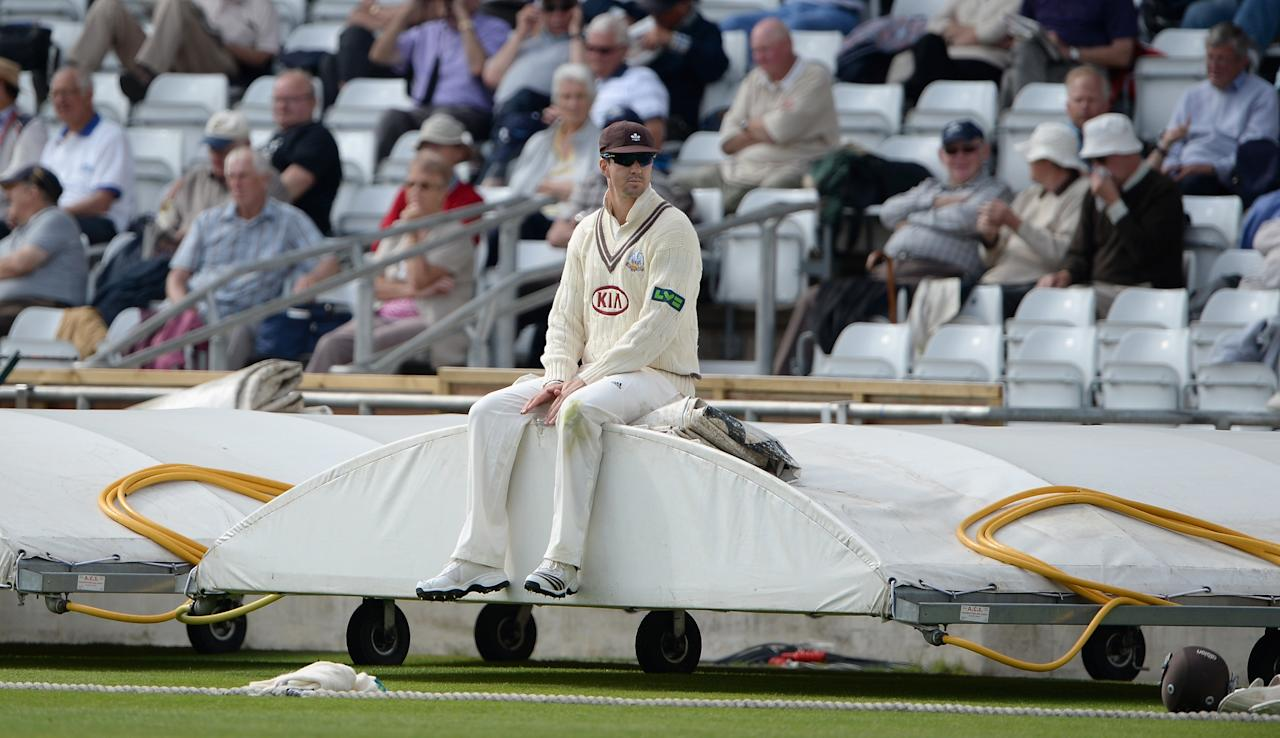 LEEDS, ENGLAND - JUNE 21:  Kevin Pietersen of Surrey sits on the covers as he waits to come back on to the field during day one of the LV County Championship Division One match between Yorkshire and Surrey at Headingley on June 21, 2013 in Leeds, England.  (Photo by Gareth Copley/Getty Images)