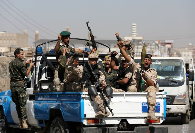FILE PHOTO: Houthi troops ride on the back of a police patrol truck after participating in a Houthi gathering in Sanaa