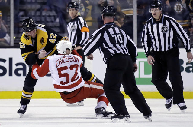 Boston Bruins right wing David Backes (42) drops Detroit Red Wings defenseman Jonathan Ericsson (52) to the ice as they fight during the second period of an NHL hockey game in Boston, Tuesday, March 6, 2018. (AP Photo/Charles Krupa)
