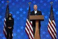 FILE - In this Nov. 5, 2020, Democratic presidential candidate former Vice President Joe Biden speaks in Wilmington, Del. Democratic vice presidential candidate Sen. Kamala Harris, D-Calif., stands at left. A tough road lies ahead for Biden who will need to chart a path forward to unite a bitterly divided nation and address America's fraught history of racism that manifested this year through the convergence of three national crises. (AP Photo/Carolyn Kaster, File)