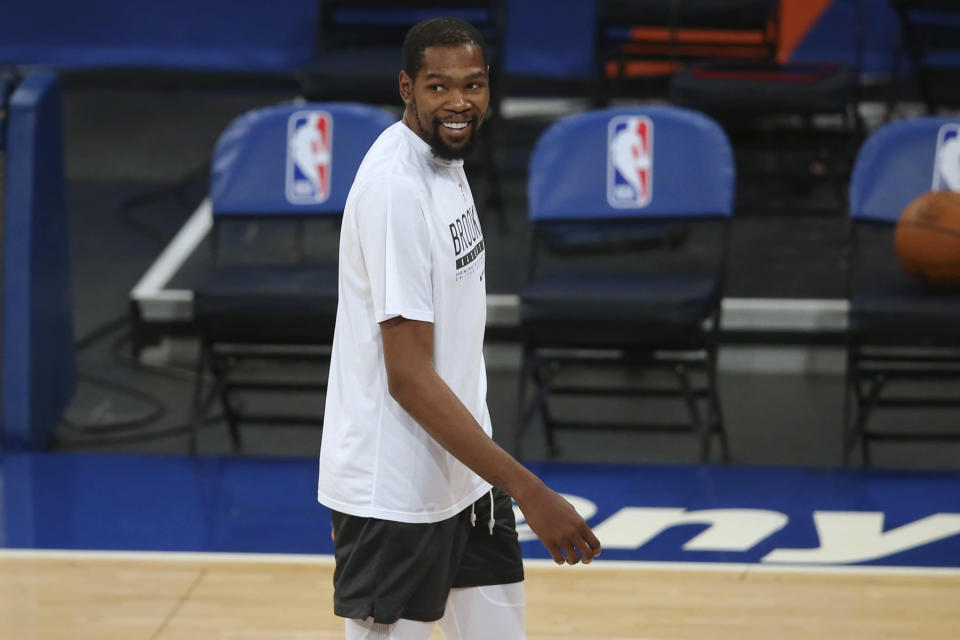 Brooklyn Nets forward Kevin Durant smiles as players warm up for the team's NBA basketball game against the New York Knicks on Wednesday, Jan. 13, 2021, in New York. (Brad Penner/Pool Photo via AP)