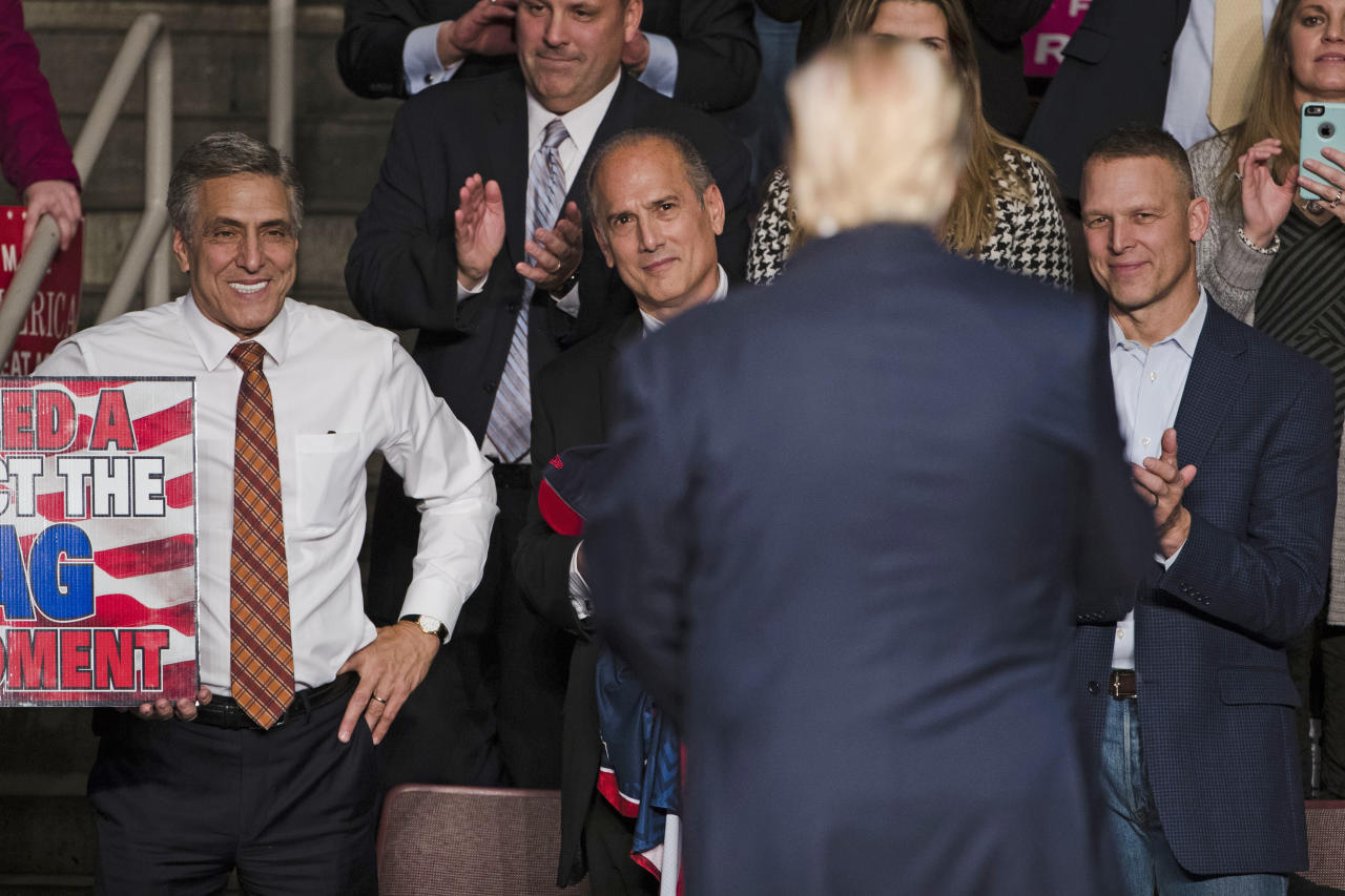 FILE - In this Dec. 15, 2016, file photo, U.S. Rep. Lou Barletta, R-Pa., left, U.S. Rep. Tom Marino, R-Pa., center left, and U.S. Rep. Scott Perry, R-Pa., right, watch as President-elect Donald Trump, center right, departs a rally in Hershey, Pa. The midnight deadline Thursday, Feb. 15, 2018, gives justices four more days to impose new boundaries, just three months before Pennsylvania's primary elections. A redrawn Pennsylvania map could help Democrats pick up seats in the U.S. House and dramatically change the state's predominantly Republican, all-male delegation. (AP Photo/Matt Rourke, File)