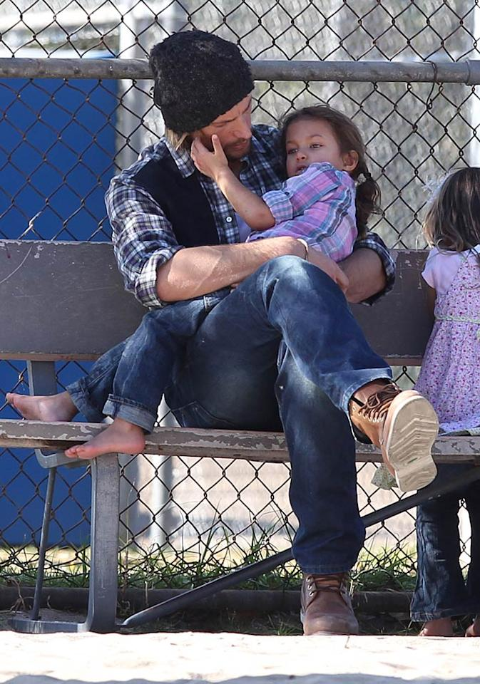 Also in the Los Angeles area on Wednesday, Halle Berry's ex-boyfirend Gabriel Aubry spent some quality time with their (shoeless!) 3-year-old daughter Nahla at a park. (12/28/2011)