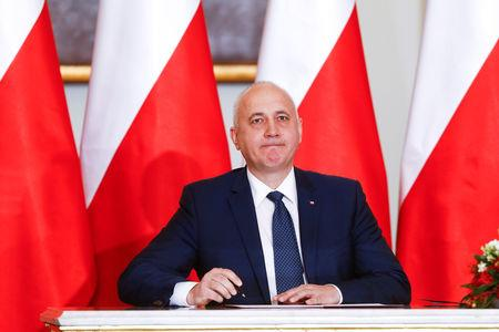 FILE PHOTO: Joachim Brudzinski Minister of Internal Affairs attends a government swearing-in ceremony at the Presidential Palace in Warsaw