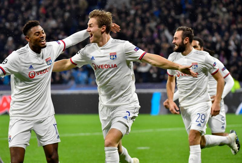 Lyon's Danish defender Joachim Andersen (C) celebrates after scoring his team's first goal during the UEFA Champions League Group G football match between Olympique Lyonnais and SL Benfica at the Decines Groupama Stadium, on November 5, 2019. (Photo by Philippe DESMAZES / AFP) (Photo by PHILIPPE DESMAZES/AFP via Getty Images)