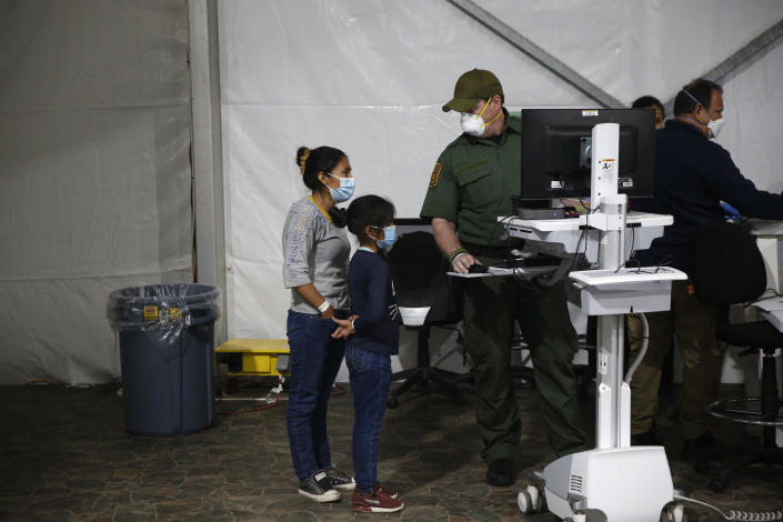 A migrant and her daughter have their biometric data entered at the intake area in the Department of Homeland Security holding facility on March 30, 2021 in Donna, Texas. / Credit: Dario Lopez-Mills / Getty Images