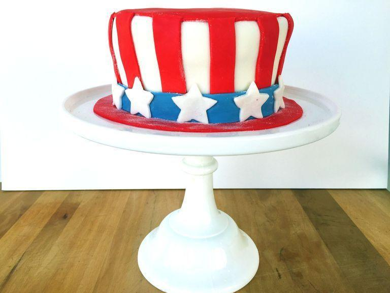 """<p>Nothing caps off July 4th like an all-American cake! Learn how to make fondant and you can impress at any holiday.</p><p><em><a href=""""https://www.goodhousekeeping.com/food-recipes/dessert/how-to/a33110/uncle-sams-hat-cake-recipe/"""" rel=""""nofollow noopener"""" target=""""_blank"""" data-ylk=""""slk:Get the recipe for Uncle Sam Hat Cake »"""" class=""""link rapid-noclick-resp"""">Get the recipe for Uncle Sam Hat Cake »</a></em></p>"""