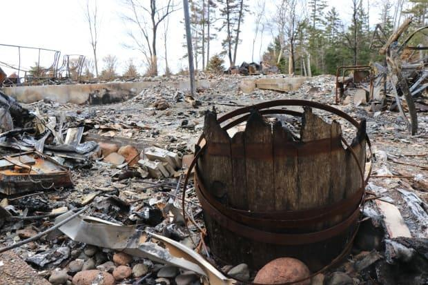 The rubble of the cottage the shooter shared with his partner on Portapique Beach Road, photographed May 13, 2020.