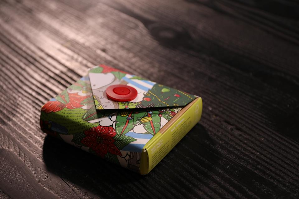 Create a bit of intrigue by leaving the edges of your gift unwrapped – you'll also save all the heartache that comes with folding corners. Photo: Yahoo Lifestyle