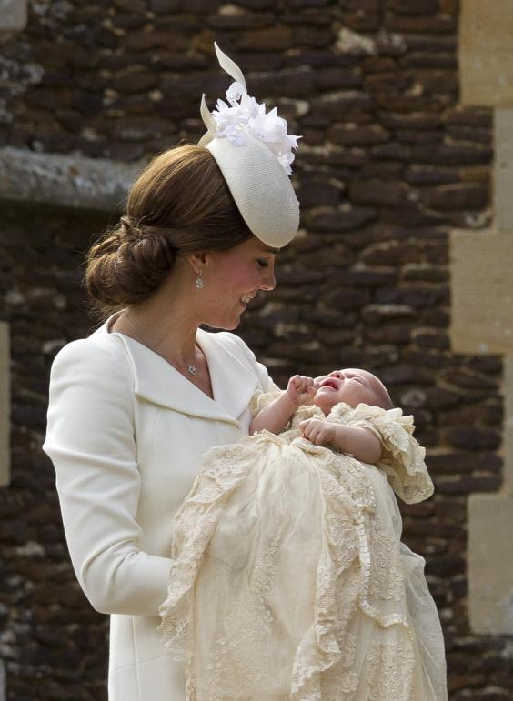 Catherine, Duchess of Cambridge, carries Princess Charlotte of Cambridge as they arrive at the Church of St Mary Magdalene on the Sandringham Estate for the Christening of Princess Charlotte of Cambridge on July 5, 2015 (Getty Images)