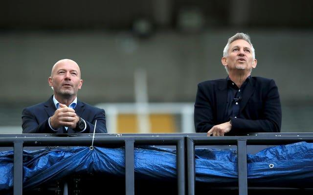 Alan Shearer (left) was working at the game as a pundit