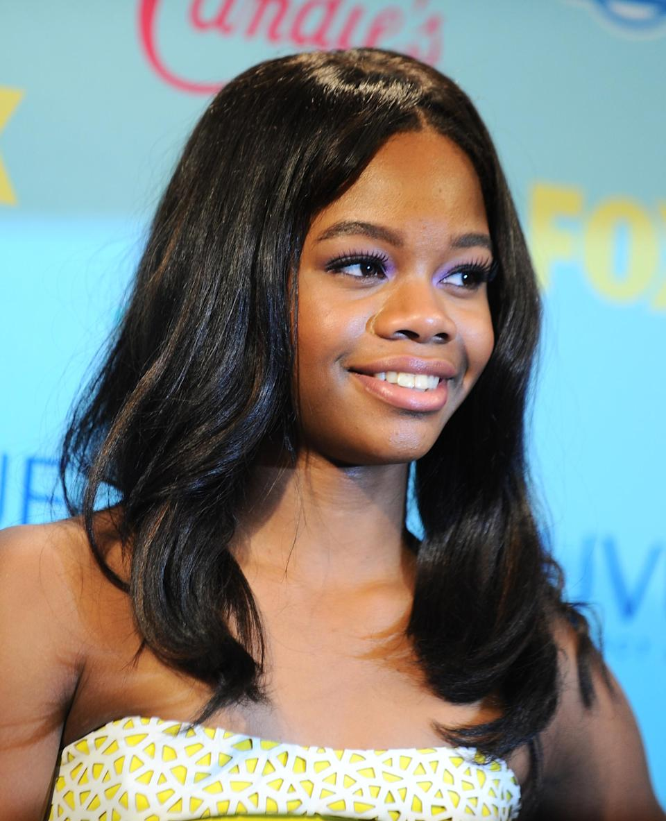Gabby Douglas poses backstage at the Teen Choice Awards at the Gibson Amphitheater on Sunday, Aug. 11, 2013, in Los Angeles. (Photo by Jordan Strauss/Invision/AP)