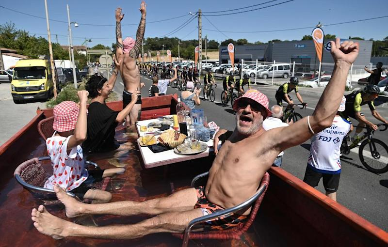 Spectators take a bath as they watch the riders during the 6th stage between Le Teil and Mont Aigoual.