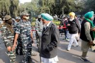 Farmer leaders arrive to attend a meeting with government representatives in New Delhi