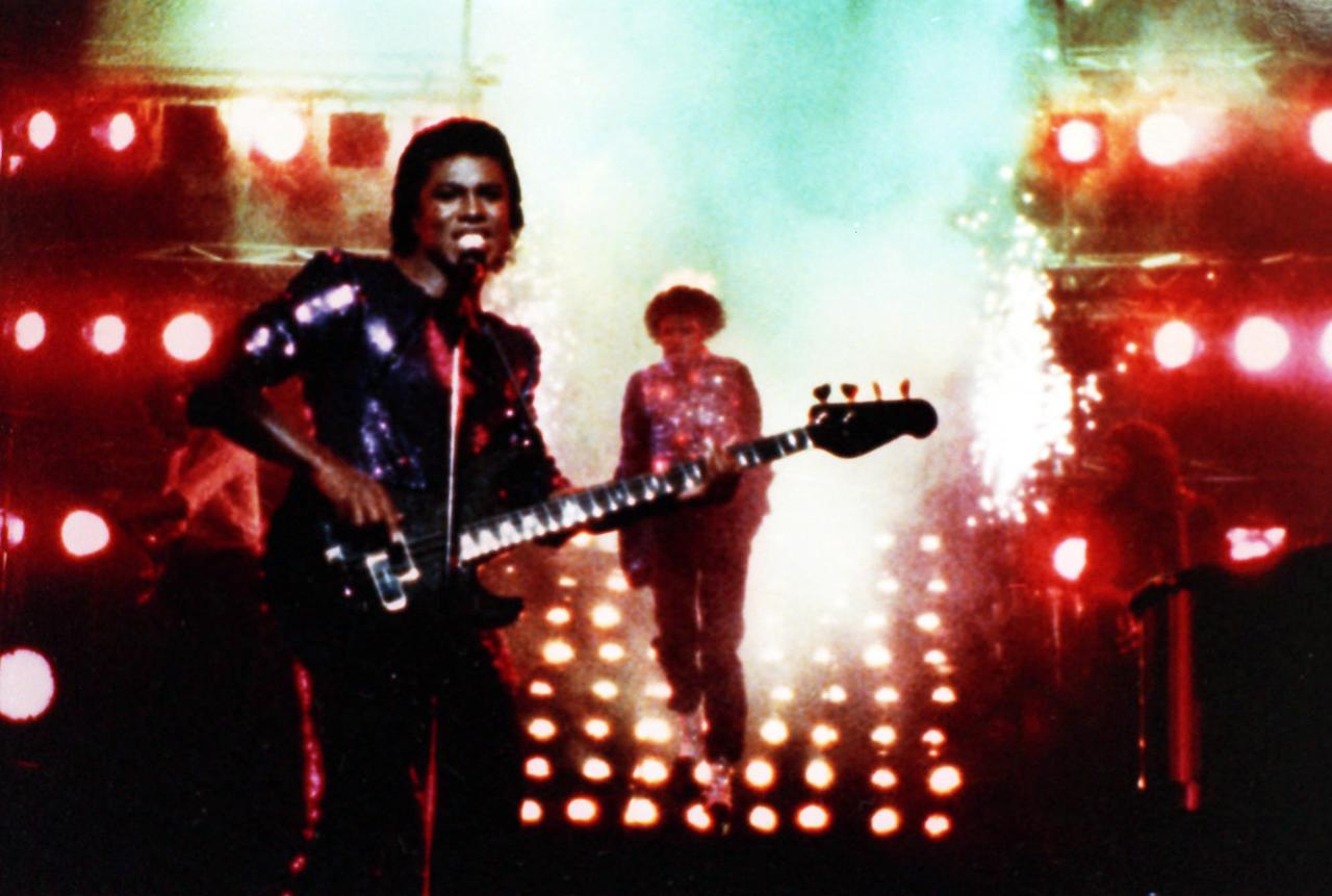 Michael Jackson, background,  is seen with his hair on fire during a taping of a Pepsi TV commercial in Los Angeles on February 1984 as brother Germaine Jackson, foreground, continues to perform apparently unaware of the situation.