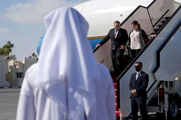 PHOTO: Secretary of State Mike Pompeo and his wife Susan step off a plane at Old Doha International Airport in Doha, Qatar, November 21, 2020. Patrick  (Pool/Reuters)